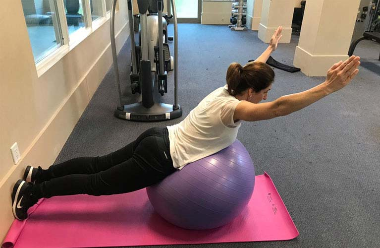 Swiss Ball Back extension exercise - Lift your torso upward