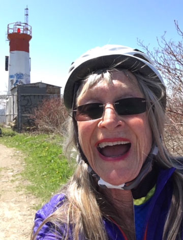 73 years old woman, enjoying cycling outdoors